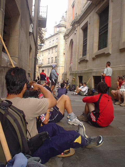 people sitting in the streets of Santiago de Compestela